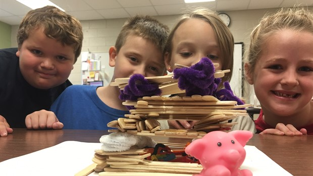 "STEM class Engineering a house for ""The Three Little Pigs""."